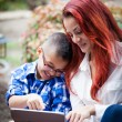 Mother and son reading from a touch pad — Stock Photo