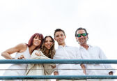 Happy smiling family on a pier — Stock Photo