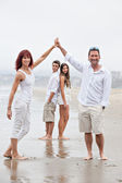 Fit happy Family at the beach — Stock Photo
