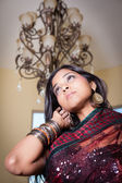 Beautiful Indian woman under a chandelier — Stock Photo