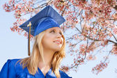 Pretty young 2013 Graduate under Cherry Blossoms — Stock Photo