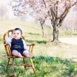 Baby thinking in a meadow — Stock Photo
