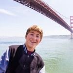 Attractive Teenager in San Francisco under Golden Gate Bridge — Stock Photo #23636945