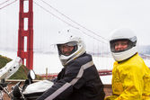 Husband and wife on a motorcycle at the Golden Gate Bridge — Stock Photo