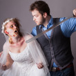Zombie Bride traped by Man - Stock Photo