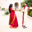 Gorgeous Indian bride and groom Dancing - Stock Photo