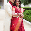 Attractive Indian bride and groom - Stock Photo