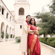Beautiful Indian bride and groom embracing — Stock Photo