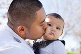 Young Father Kissing his son — Stock Photo