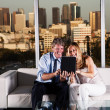 Mature couple at night working with skyline — Stockfoto #25574313