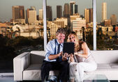 Mature couple at night working with skyline — Stock Photo