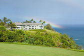 Tropical traquil living with a rainbow on the cliffs of Kauai — Stock Photo