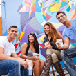 Four friends sharing Coffee — Stock Photo