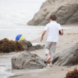 Child running on the beach — Stock Photo