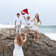 Children gathering for a family Picture Xmas Day at the Beach in Los Angeles — Stock Photo #31420525
