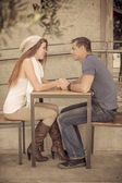 Young Couple at a cafe — Stock Photo