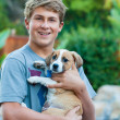 Happy Teenager with a new Puppy — Stock Photo