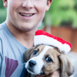 Happy Teenager with a new Christmas Puppy — Stock Photo