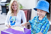 Child opening a present — Stock Photo