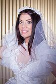 Beautiful Bride smiling at camera — Stockfoto