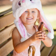 Pretty young girl in a Bunny hat and chocolate — Stock Photo #44548919