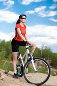 Woman bicyclist — Stock Photo