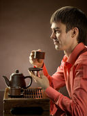Man with tea — Stock Photo
