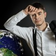 Businessman with terrestrial globe — Stock Photo