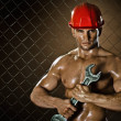 Workman big wrench — Stock Photo