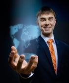 Businessman hold in hand terrestrial globe — Stock Photo