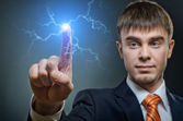 Businessman pointing touch electric strike  lightning — Stock Photo