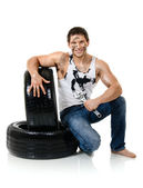 Workman hold rubber-tire — Stock Photo