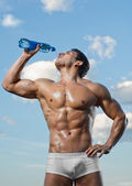 Sportsman drinks water — Stock Photo