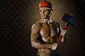 Workman with big tup — Stock Photo