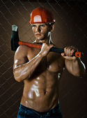 Workman with big  heavy axe — Stock Photo