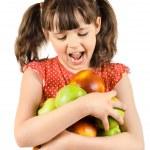 Little girl holding apples — Stock Photo #44634131