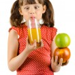 Little girl with apples and  drink  juice — Stock Photo #44634135