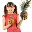 Girl hold two pineapples — Stock Photo #44634157