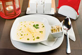 Plate with cheese cream soup — Stock Photo