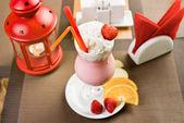 Glass with strawberry milk shake — Stock Photo