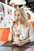 Woman in Cafe drink coffee- cocktail — Stock Photo