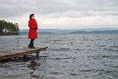 Woman on water moorage — Stock Photo
