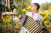 Fiancee listen,  bridegroom play on accordion — Stock Photo