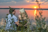 Couple outdoor on sunset — Stock Photo