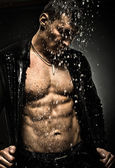 Muscular,sexy guy under shower — Stock Photo