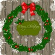 Christmas card with wreath. — Stockvectorbeeld