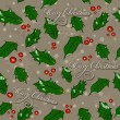 Seamless Christmas texture with holly leaves. — Imagen vectorial