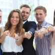 Happy group of executives all pointing at you — Stock Photo