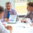 Manager discussing work with his colleagues — Stock Photo #12859370