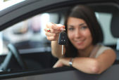 Happy smiling woman with car key — Stock Photo